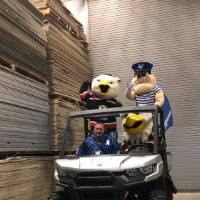 louie with the griffins mascots on the buggie